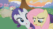 Sweetie Drops and Lyra Heartstrings fighting each other along with other ponies S2E03