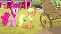 Applejack grinning nervously at Pinkie S4E09