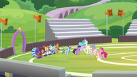 Twilight and friends laughing on the field S9E15