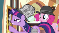 Twilight looking at portrait closely S2E24