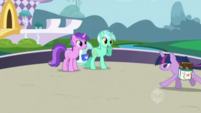 592px-Twilight running past waving ponies S01E01