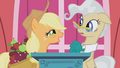 Applejack on stage with Mayor Mare S1E04.png
