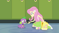Fluttershy feeds Spike a dog biscuit EG.png