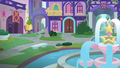 Side view of school's fountain square S8E12.png
