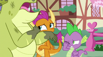 Sludge walks past Spike and Smolder in pain S8E24
