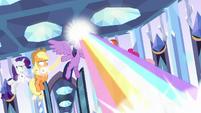 Twilight Sparkle blasting a rainbow laser S9E1