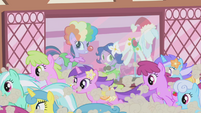 Ponies run past costume shop S1E3
