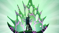Queen Chrysalis sitting on a cracking throne S6E26