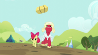 Orchard Blossom hurls the hay bale away S5E17