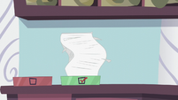 Stack of Princess Dress orders in outbox S5E14