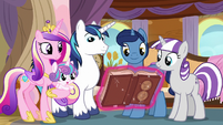 Twilight's family looks at the almanac S7E22