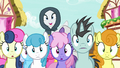 Cloaked Rarity appears over crowd of ponies S7E19.png