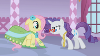 Rarity backing Fluttershy into a corner S1E14