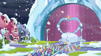 Applejack, Fluttershy, and Rainbow in front of the Crystal Empire crowd S6E2