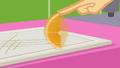 Applejack spinning an orange wedge SS9.png
