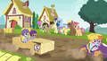 Ponies doing a wave for passing racers S6E14.png