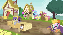 Ponies doing a wave for passing racers S6E14