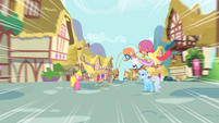 Scootaloo speeding through Ponyville S4E05
