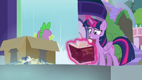 Twilight frantically opens the book S9E5