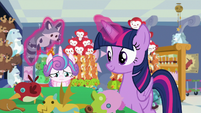 Twilight placing toys on the checkout line S7E3