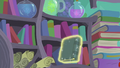 Book being levitated out of the shelf S6E2.png