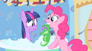 Pinkie Pie pulls Gummy out of the tub S1E15