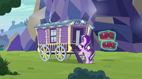 Starlight knocking on Trixie's wagon S8E19
