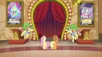 Flim and Flam putting their hats on S6E20