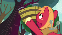 Big Mac holding bucket to catch apples S8E12