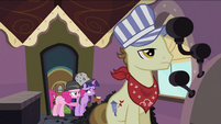 Twilight and Pinkie behind the conductor S2E24