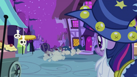 Twilight looking at foals running away S2E04