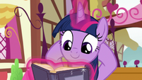 Twilight lounging and reading a book S8E18