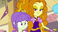 Adagio singing and stroking student's hair EG2