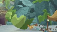 Applejack stops the boulder with her hooves S7E25
