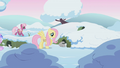 Fluttershy wakes a bunny while Cheerilee walks by in background S1E11.png