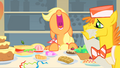 Mr. Cake cleaning the table just as Applejack is about to start eating S1E22.png