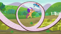 Scootaloo jumps while the scooter scoots on a circular track S6E4