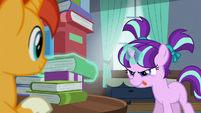 Filly Starlight trying to levitate a book out of the book tower S5E26