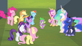 Mane 6 and princesses cheering for Spike S4E24.png