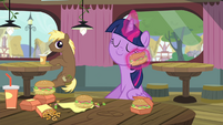 Twilight wiping her face with a hay burger S4E15