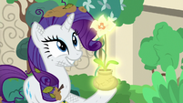 Mistmane's flower glows in Rarity's hoof S7E25