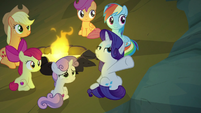 Rarity gesturing at the cave walls S7E16