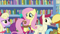 Fluttershy flying past Martingale fans S9E21