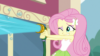 Fluttershy spraying water from a hose EGS1