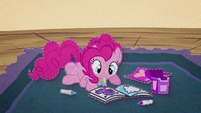 Pinkie Pie coloring in a coloring book BFHHS3