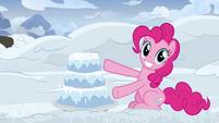 Pinkie Pie presenting a snow cake S7E11