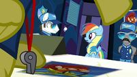 Rainbow looking at white pegasus to the left S3E7