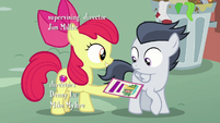 Apple Bloom giving Rumble a camp flyer S7E21