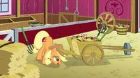 Applejack closing a wheelbarrow S5E03