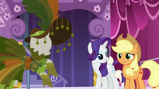 File:Applejack looking at Rarity's new dress design S7E9.png